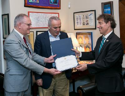 L to R: David Mehler, Former World Chess Champion Garry Kasparov, Representative Jamie Raskin, presenting Congressional Certificate of Special Recognition.